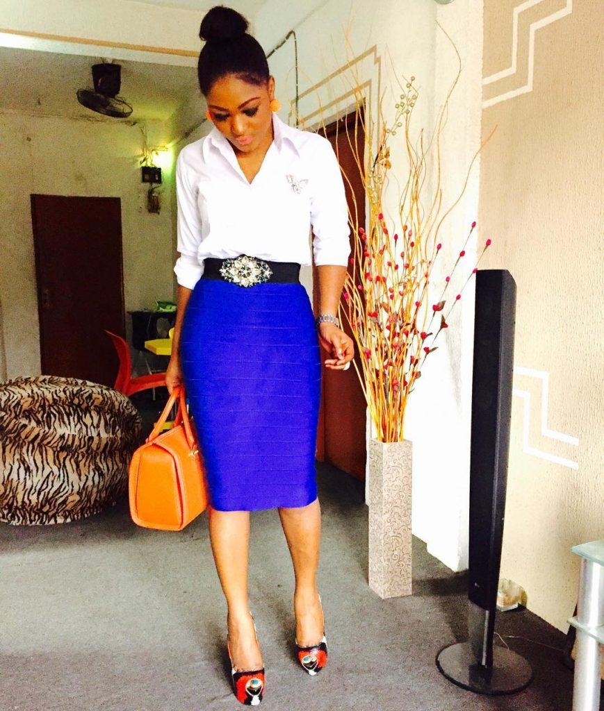 Look 2: @zionbaby05 slays in a white button down shirt and a blue bandage skirt!
