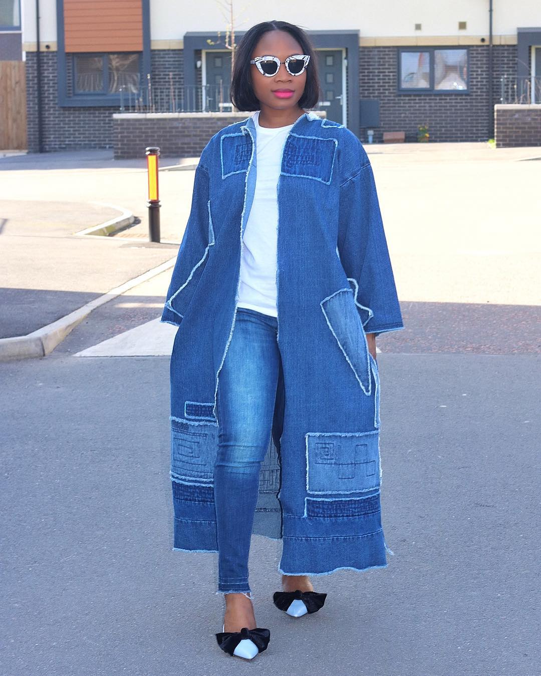 Damilola of Edaowo Fashion in her oversized denim jacket and lush bow Zara shoes.