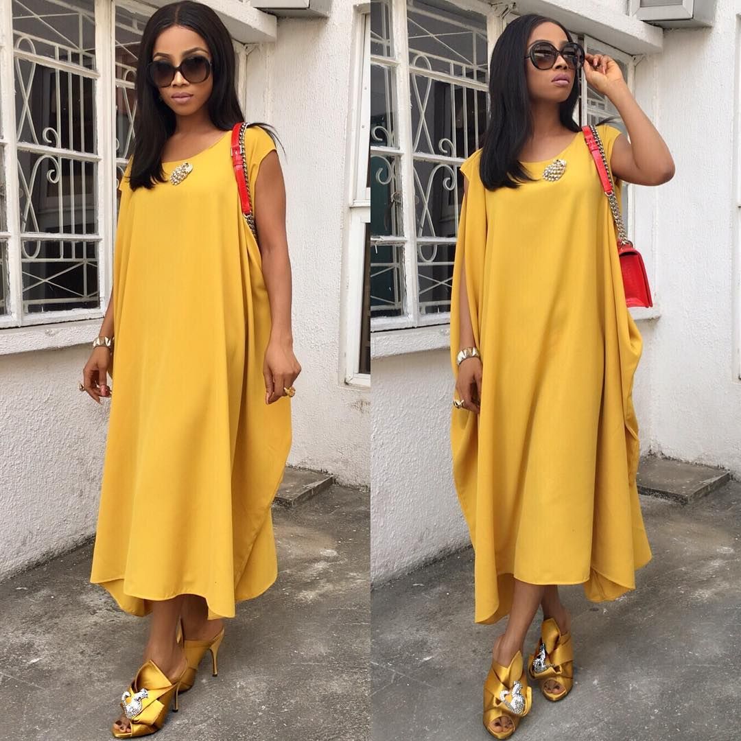 Toke slaying effortlessly in a yellow boho dress and matching yellow shoes!