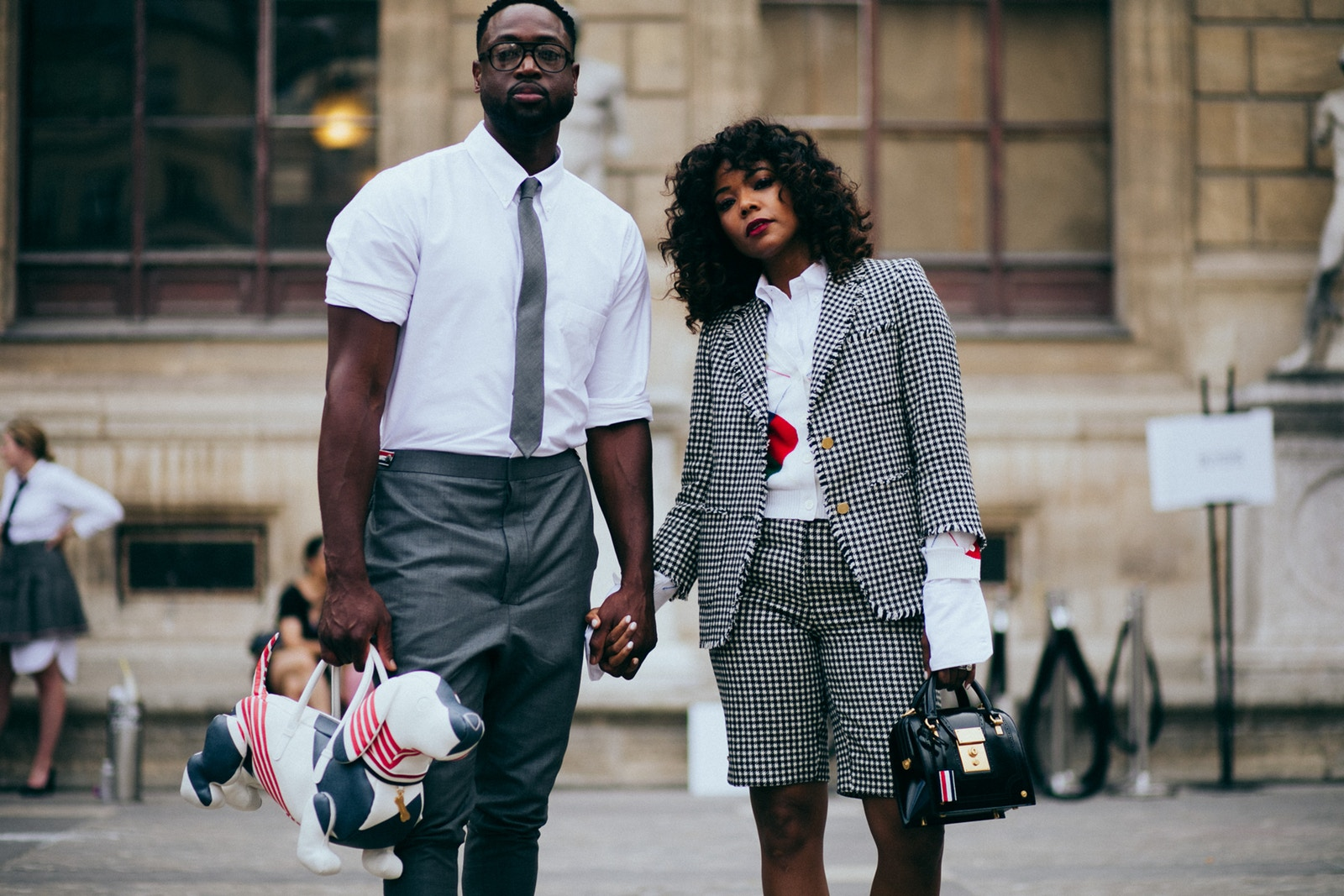 https-hypebeast.comimage201707dwyane-wade-paris-fashion-week-2017-interview-2018-spring-summer-thom-browne-dog-bag-purse-gabrielle-union-1